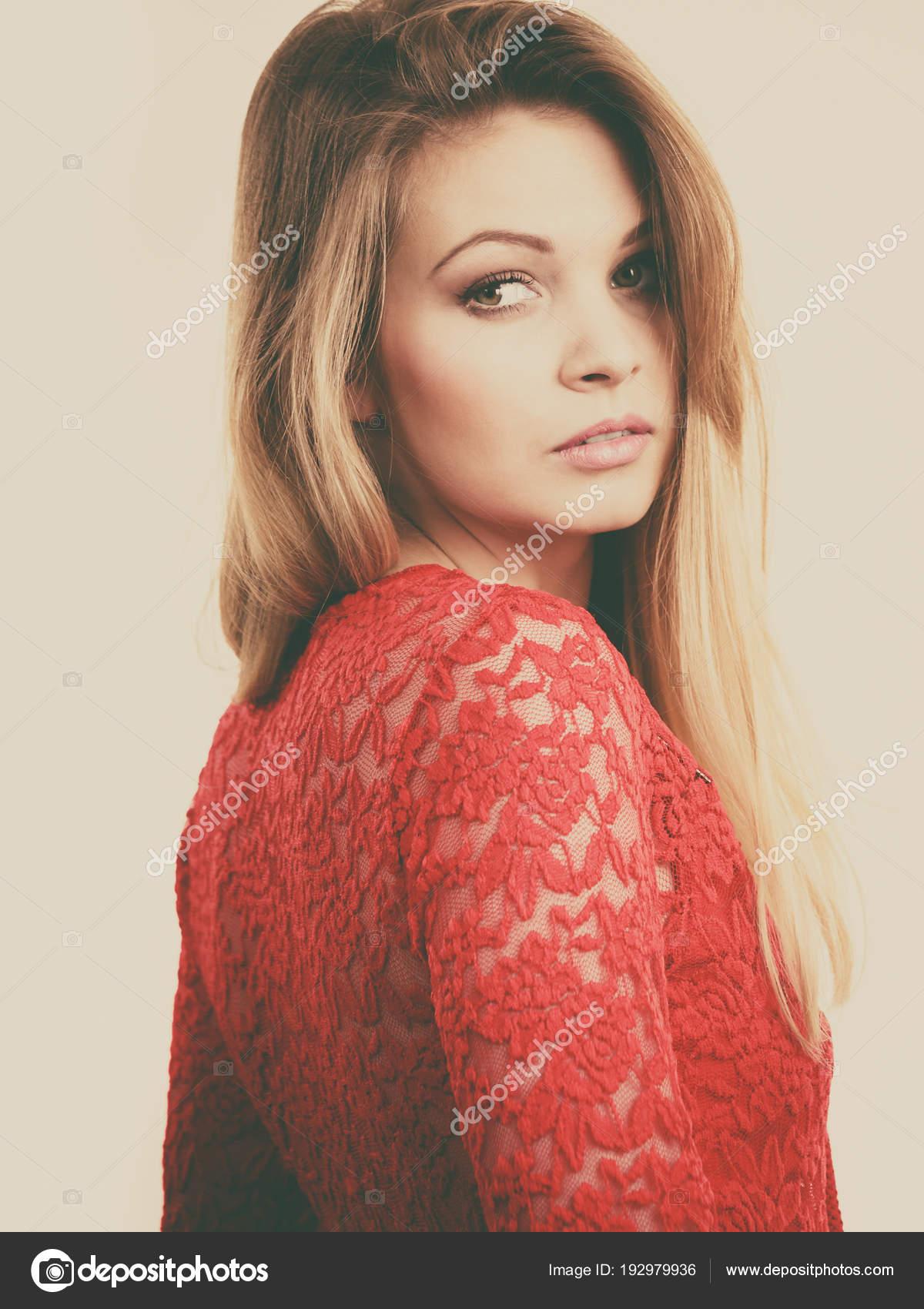 516fa0838c445a Elegant young woman wearing red top — Stock Photo © Anetlanda #192979936