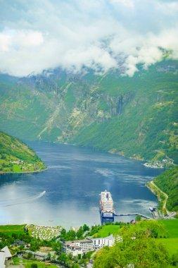 Ferryboat on fjord, Geiranger village Norway.