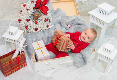 Christmas baby. little cute girl five months on the eve of Chris