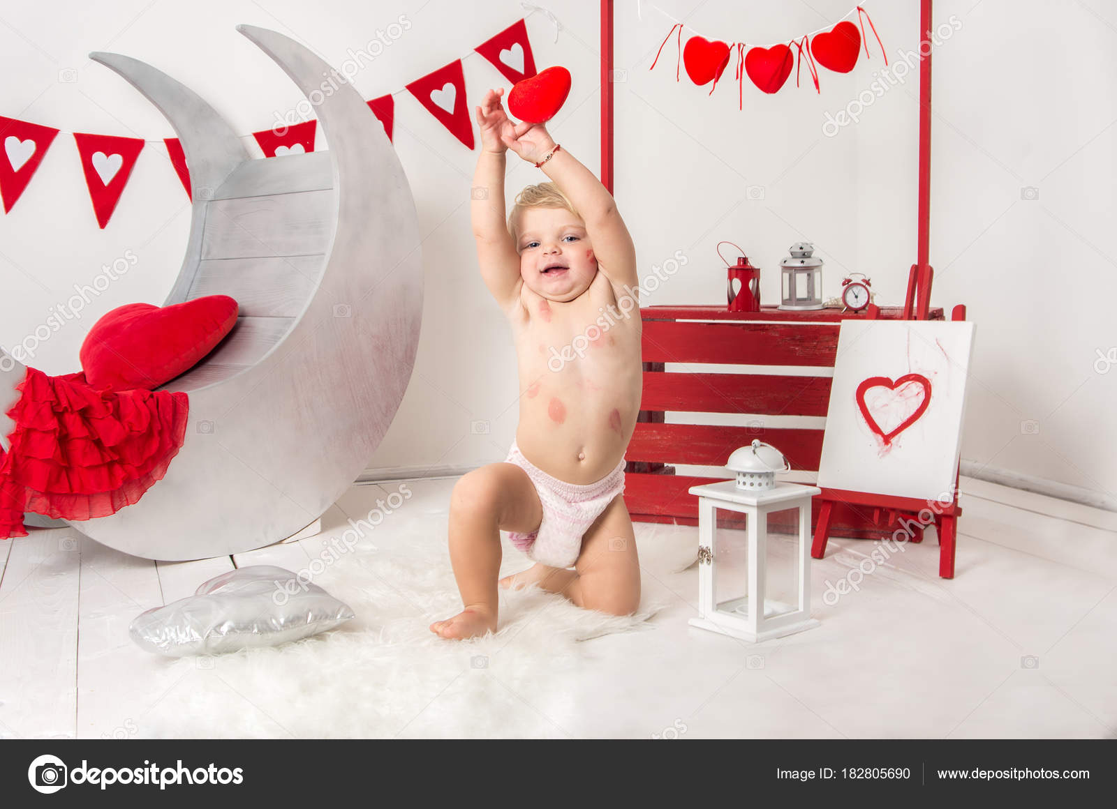 Portrait Of A Cute Little Baby Girl In A Decorated Holiday Studio Of