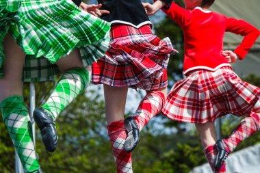 Highland dancer at highland games in scotland