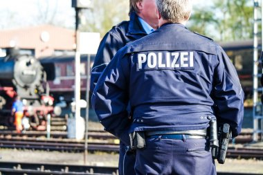German police man with the blue jacket