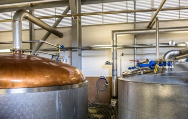 GLENBEG, ARDNAMURCHAN SCOTLAND - MAY 26 2017 : Ardnamurchan distillery is producing whisky since 2014 and actually expanding their warehouses in Glenbeg stock vector
