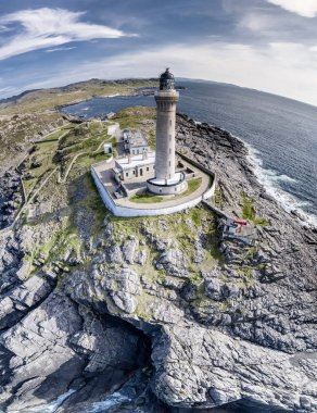 Stunning aerial shot of Ardnamurchan Point, Great Britains most westerly point, with lighthouse and the beautiful white beaches and costline in the background