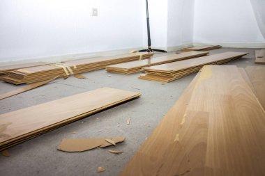 Room full of removed laminate lying on floor