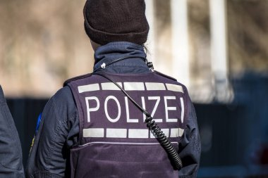German Federal police officer woman protecting the city
