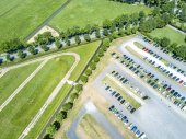 Aerial of a huge parking lot in the green