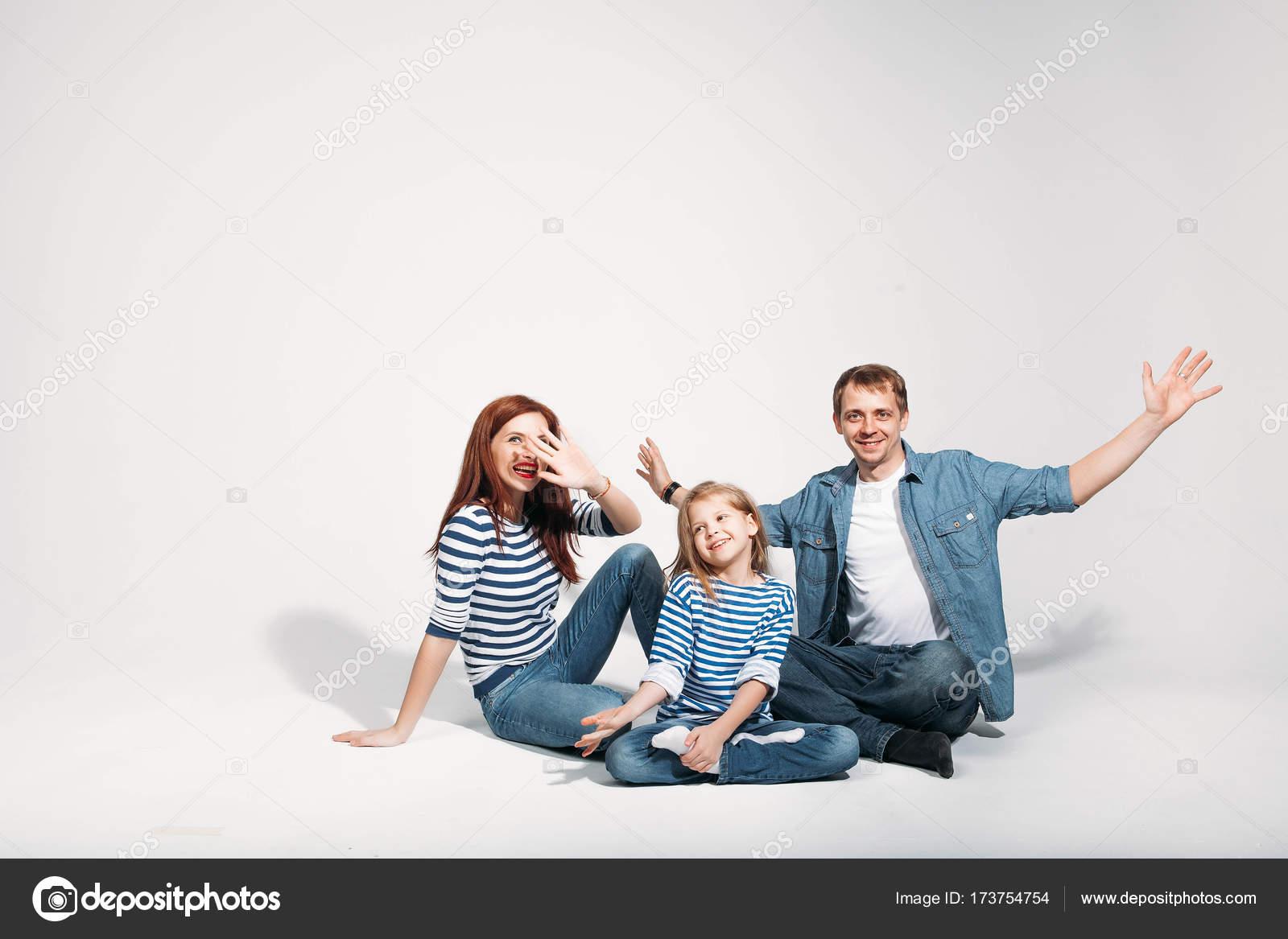 Happy family portrait sitting on white background isolated stock photo
