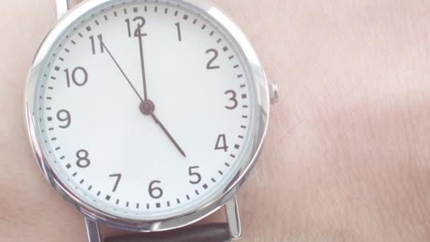 Close up of a Caucasian man wearing a wrist watch