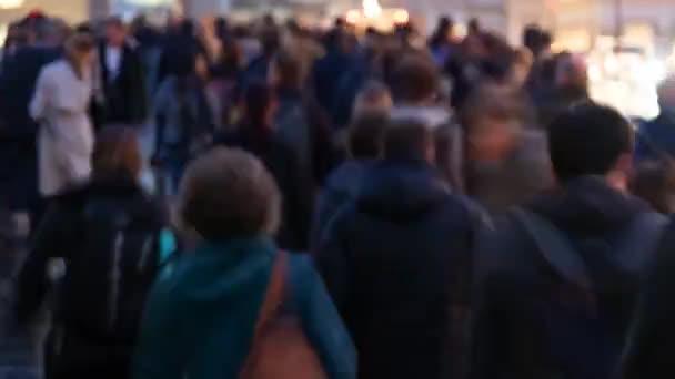 LONDON / UNITED KINGDOM  - OCTOBER 2019 : Timelapse of commuters walking in the rain at rush hour on London Bridge, London
