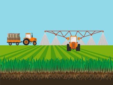 Tractor fertilizing field.