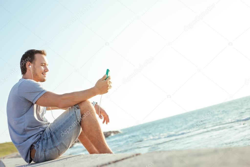 young and handsome man with mobile smartphone