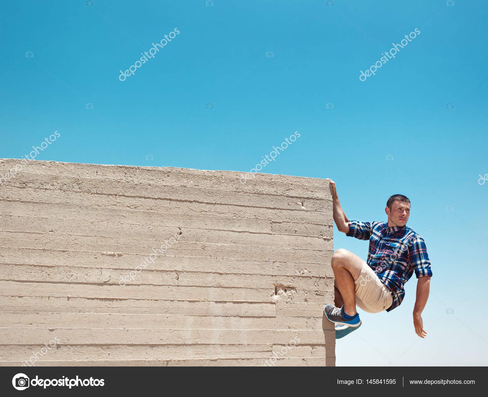 Man Hanging On Cement Wall Stock Photo Mooshny 145841595
