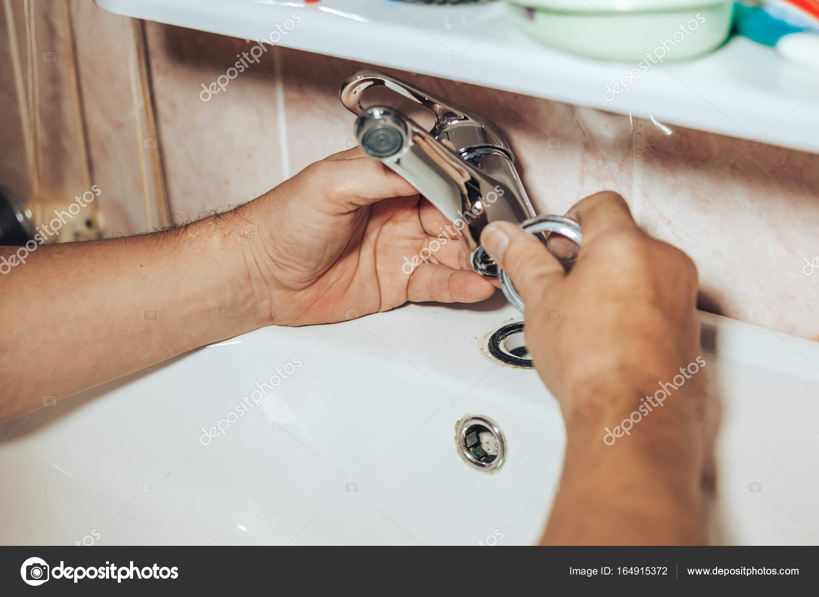 Man repair and fixing leaky new faucet in bathroom — Stock Photo ...