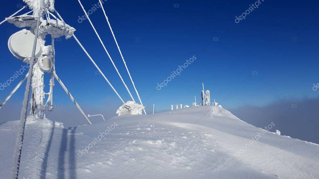 Ceahlau weather station in wintr landscape. Romania