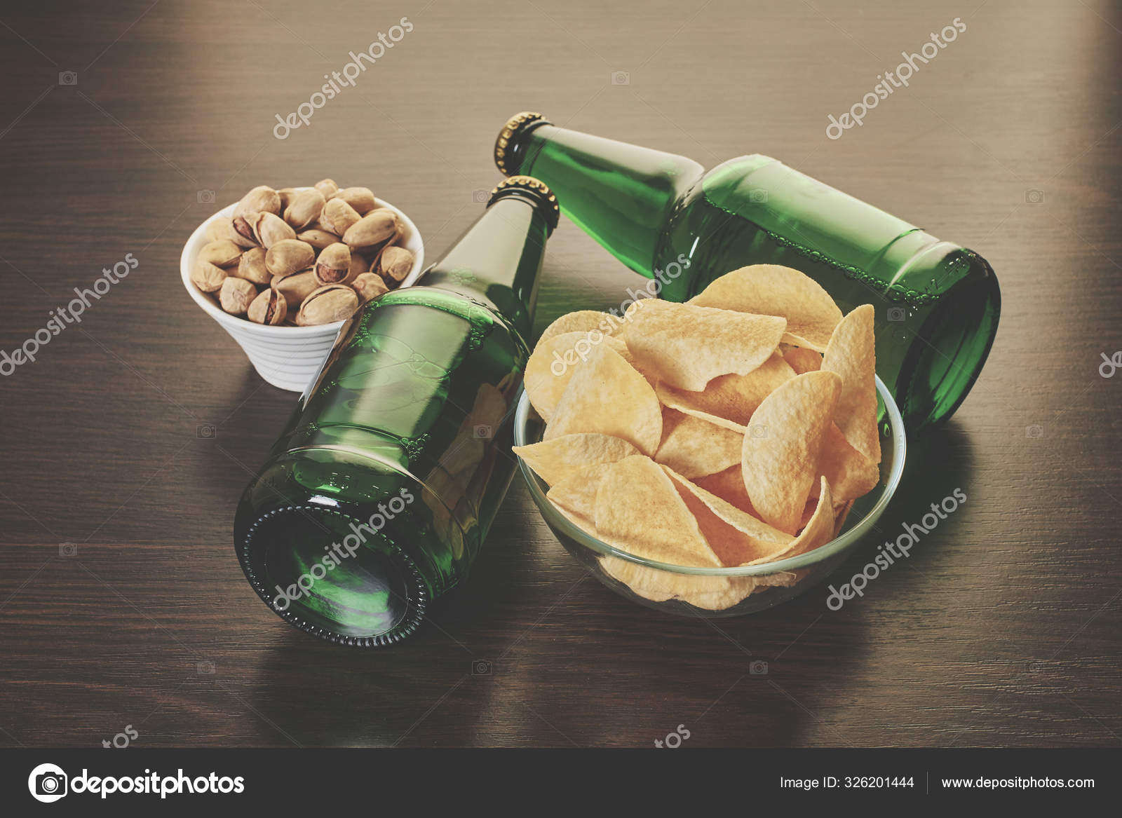 Beer in bottles with snack