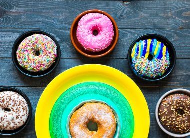 Colorful Donuts breakfast composition