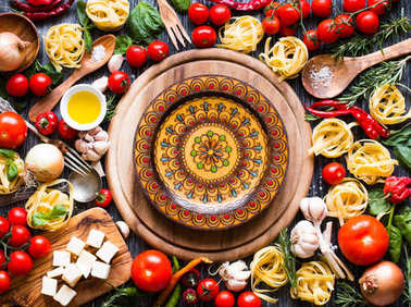 Top view of all the necessary food components to make a classic Italian pasta with tomato sauce with basil and olive oil