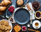 Fotografie Top view of a wooden with  of cakes, fruits, coffee