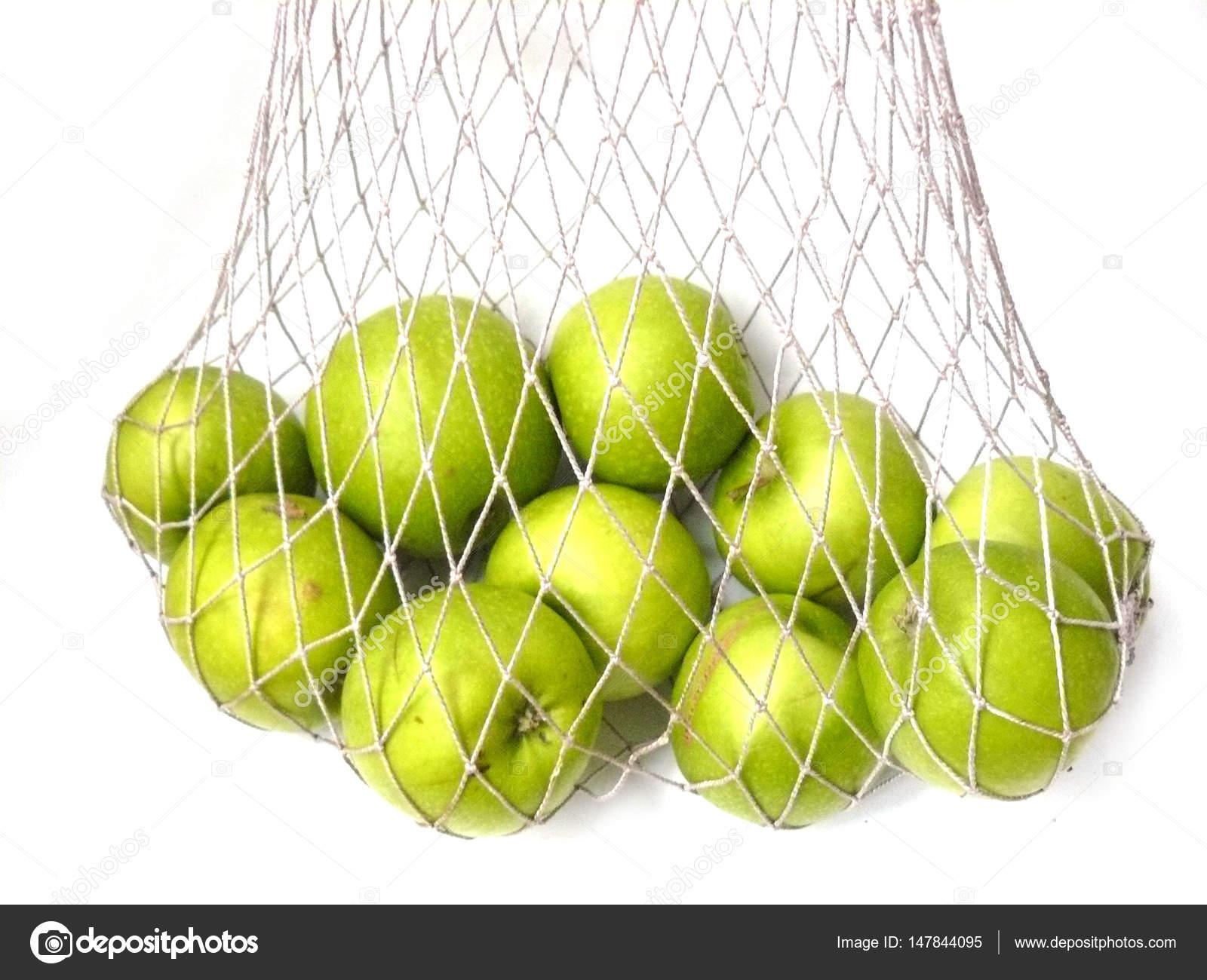 Äpfel in einer Tasche, Äpfel im Netzwerk-Markt-Tasche, grüne ...