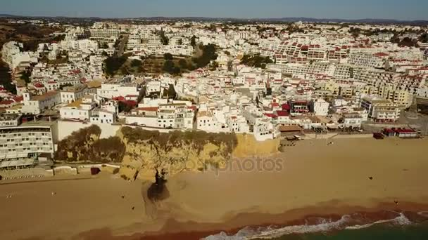 Aerial view of touristic Albufeira  with wide sandy beach and cliffs by Atlantic Ocean, Algarve, Portugal