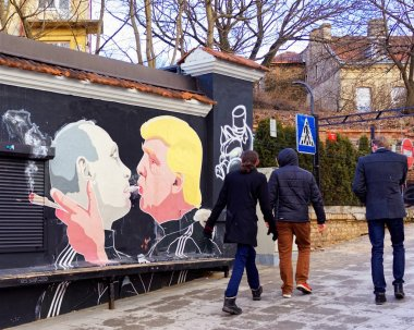 People at Donald Trump kissing Vladimir Putin mural in Vilnius