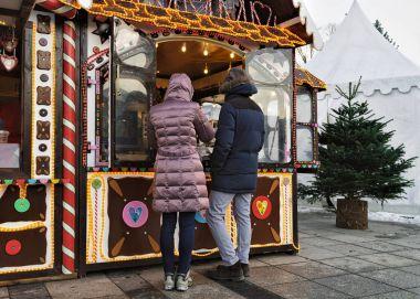 Christmas souvenir shop and visitors Vilnius Lithuania