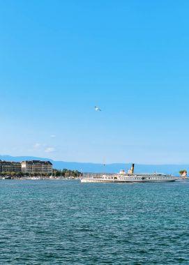 Steam ship at Geneva Lake near embankment Promenade du Lac