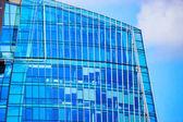 Glass windows in modern office building skyscraper in business district