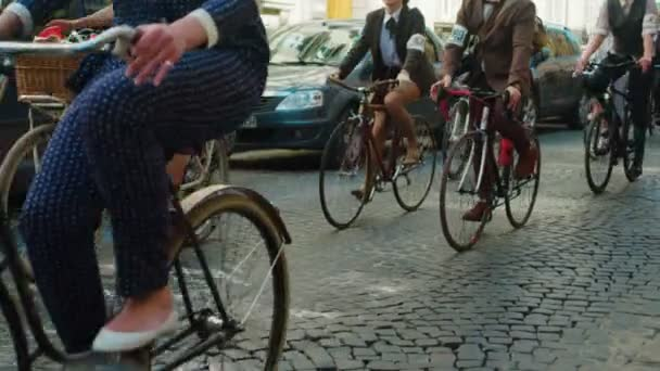 Vienna, Austria - April 2017 Group of byciclists doing retro bike marathon on the city streets. People riding their bicycles on the city road.