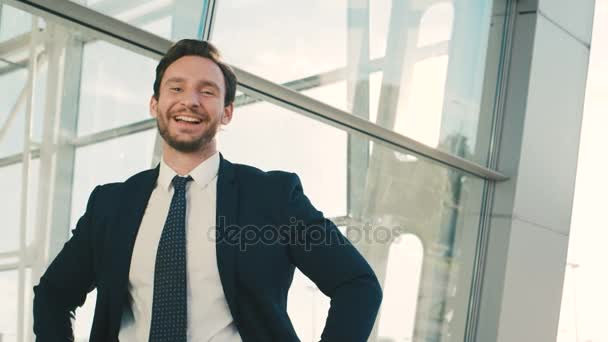 Happy attractive businessman showing different emitions. Happy, fynny emotions. Outdoors near office windows. close up