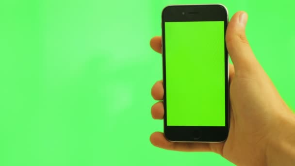 Telefono Cellulare Con Lo Schermo Verde Uomo Che Tiene Nero