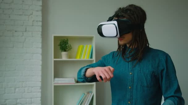 83ff161cb927 Young hipster man with dreadlocks using virtual reality headset and playing  games at home. Vr glasses.– stock footage