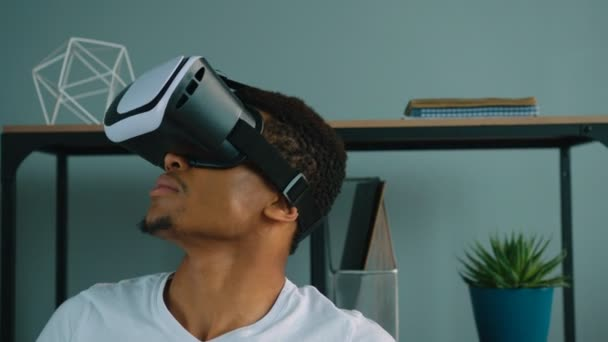 Black african american man using vr glasses at the office. Exited man looking aroung