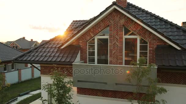 Close up shot of brown roof of big modern house during the sunshine. Dolly shot.