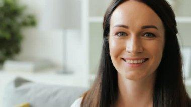 Happy brunette woman on sofa