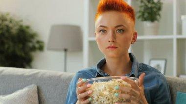 Redhead woman in blue shirt