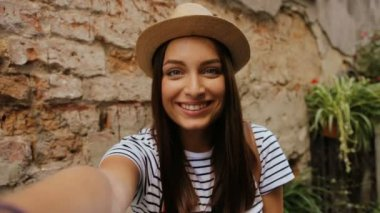 Young pretty girl in hat