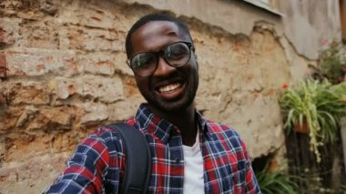 African guy in glasses