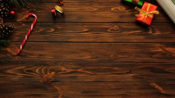 top view of brown wooden table with Christmas decorations