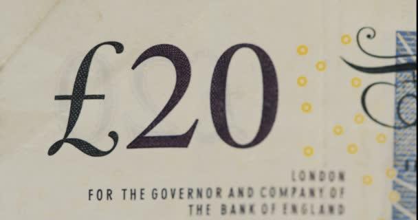 Makro číslo 20 na líci bankovky libry. GBP. zblízka