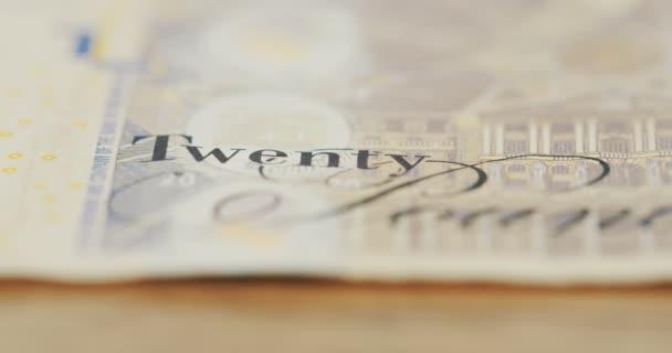 Makro fotografování slov dvacet liber na bankovky. GBP. zblízka