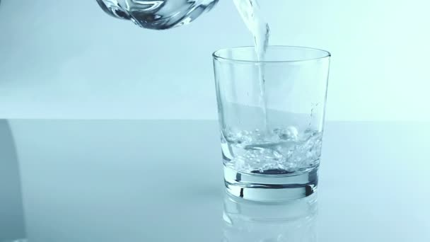filling a glass with water through bottle, nutrition concept