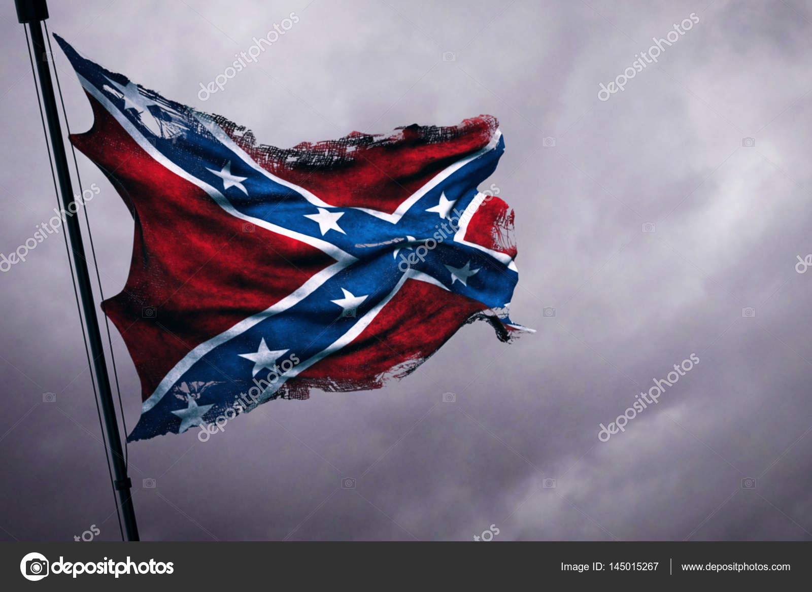 Closeup of ripped tear grunge old waving confederate flag of the ripped tear grunge old closeup of waving confederate flag of the national states of america us fabric texture american symbol sign on cloudy sky biocorpaavc