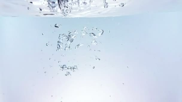 fresh bubbles splash falling down into water, shot in slow motion on white background, purity and clean, nutrition and health care