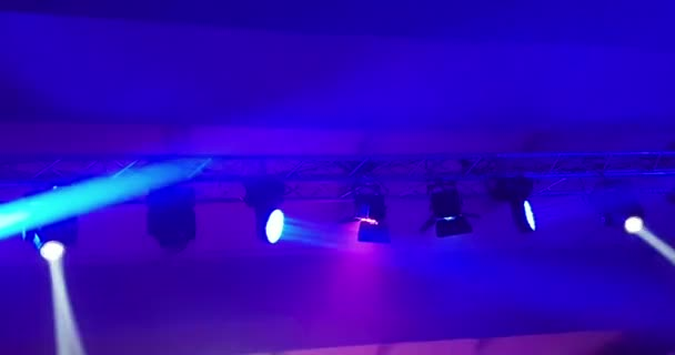 Abstract Blue And Violet Purple Bright Shiny Stage Lights Flashing Movement Entertainment Spotlight Projectors In The Dark Blue Soft Light Spotlight Strike On Black Background