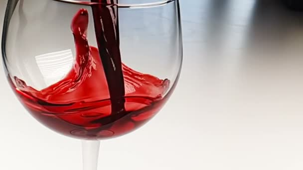 pouring red wine into drink glass on white background, nutrition health-care concept, shooting in slow