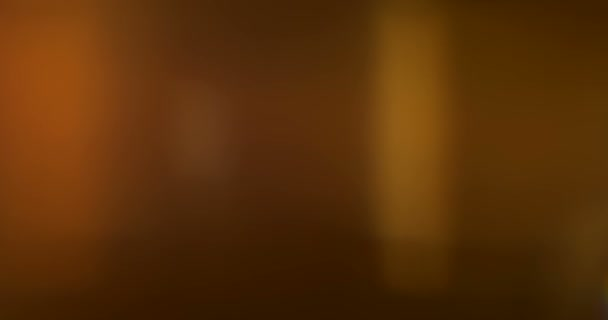 abstract golden light pulses and glows lights leaks effect motion background, warm