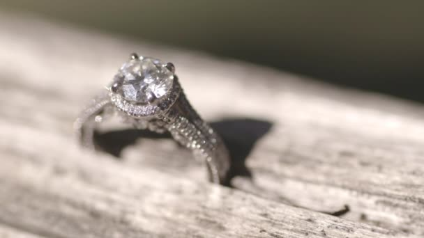 white gold engagement ring with diamond on wooden surface