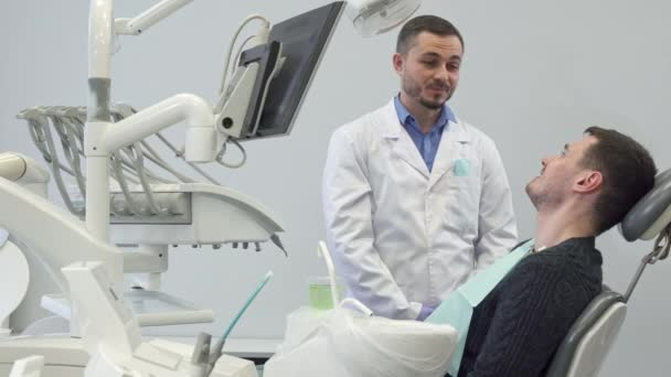 Dentist talks to his male client